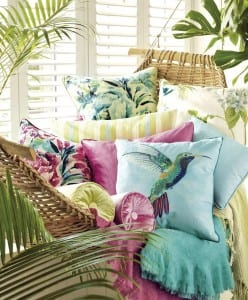 Beautiful botanical interiors; indoor hammock with a selection of coloured cushions to brighten your home