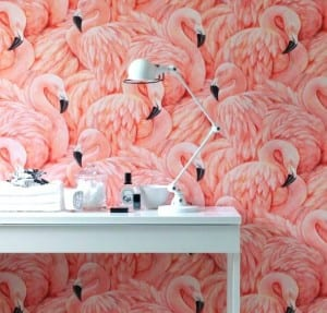 Flamingo wallpaper with a white telephone table in front of it