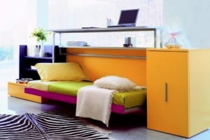 Multipurpose desk-bed with fitted storage in bold solid colours