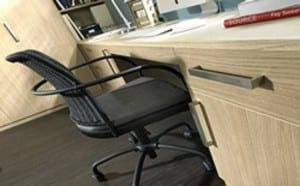 Home study showing desk top, office chair and drawer / cupboard storage in aragon oak finish