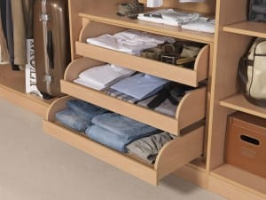 Fitted wardrobe interior showing storage options including interior drawers