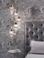 grey wallpaper and headboard