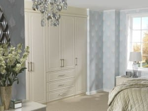 Madrid range in a jasmine finish; fitted linen press feature within the wardrobe run