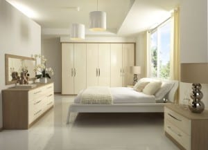 Milan fitted range in a two-tone cream gloss and aragon oak
