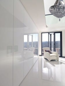 Milan fitted wardrobe run highlighting the high white gloss finish