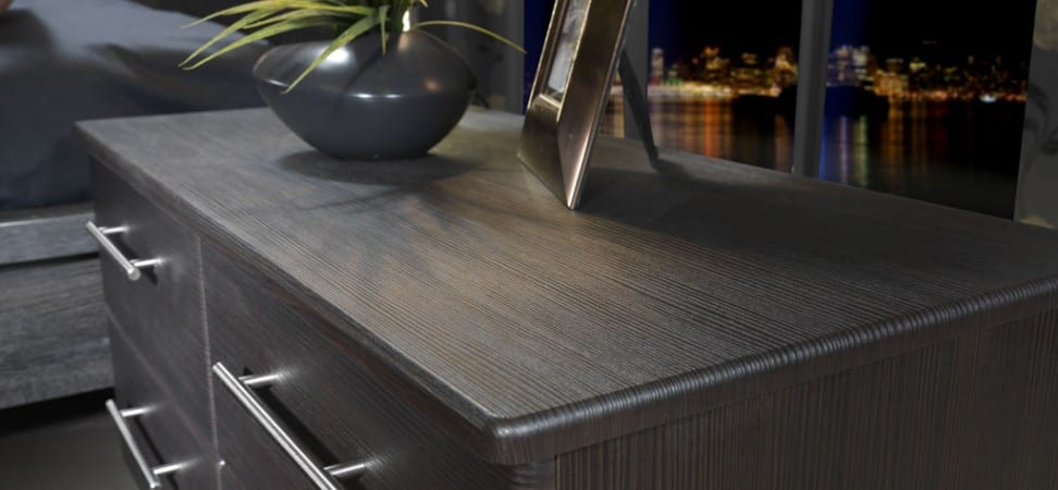 Milan range in a dark avola finish; freestanding low unit highlighting the woodgrain effect