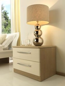 Milan range in cream gloss and aragon oak; fitted bedside cabinet