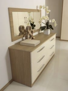Milan range in cream gloss and aragon oak; fitted drawer chest and matching wall mirror