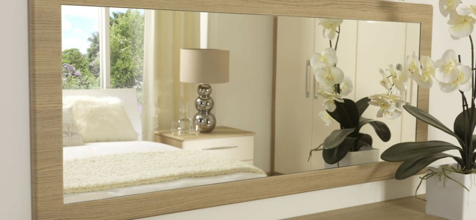 Milan range in cream gloss and aragon oak; wall mirror highlighting the woodgrain effect