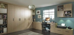 Fitted home office in aragon oak showing wardrobe run, external shelving, desk area and surrounding fitted storage