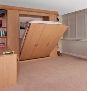Palma fitted range in a beech finish; foldaway bed in action