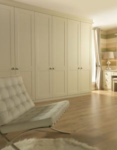 Shaker range in a chalk white finish; fitted wardrobe run