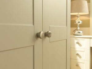 Shaker range in a chalk white finish; fitted wardrobe with brushed chrome knobs