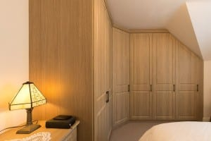 fitted wardrobe; sloping ceiling