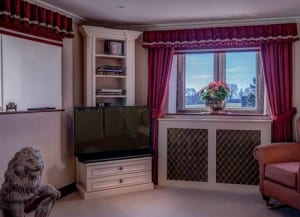 Lounge cabinet, thick curtains and wall heater