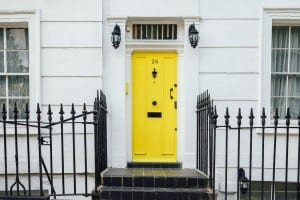 Property with yellow front door