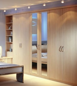 Mirrored wardrobe run with pelmet lights to create a light and spacious feel
