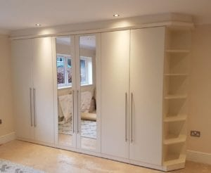 Cream mirrored fitted wardrobe creates feeling of space