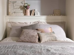 Choose cosy bedding and soft furnishings