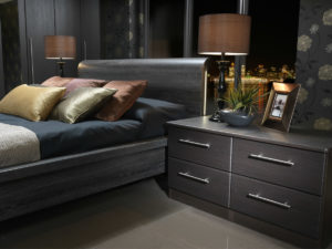 Dark coloured bedroom furniture