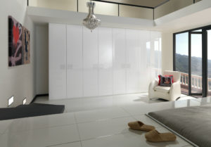 Contemporary white gloss wardrobes for a bright and airy bedroom