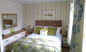 Green check/floral fitted bedroom