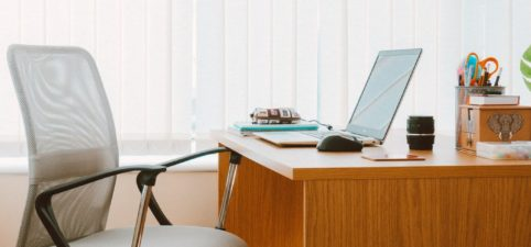 office desk with blinds